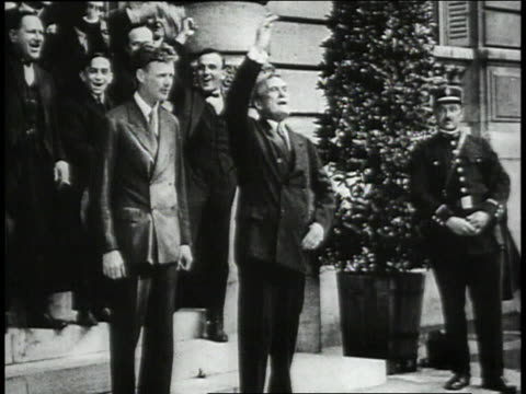 Lindbergh and Ambassador Herrick standing outside American Embassy and waving/ Lindbergh / Ambassador Herrick / Lindbergh and Ambassador Herrick...