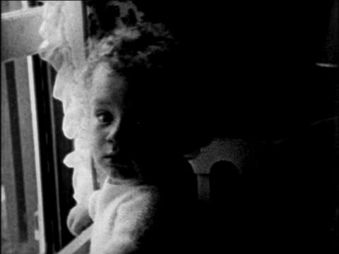 lindbergh baby crawling in crib indoors / sequence - 1932年点の映像素材/bロール