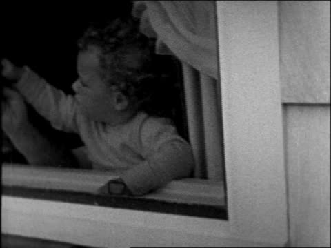 lindbergh baby pounding against window / sequence - anno 1931 video stock e b–roll