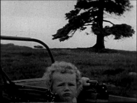 lindbergh baby sitting in baby carriage outdoors / sequence - anno 1931 video stock e b–roll