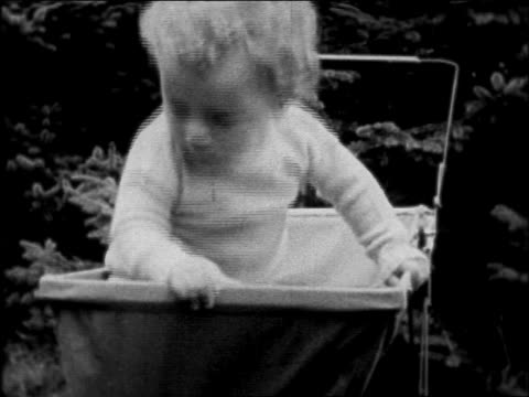 lindbergh baby sitting in baby carriage outdoors - pushchair stock videos and b-roll footage