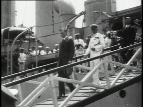 Lindbergh exiting ship and greeting crowd with hand shakes / New York New York United States