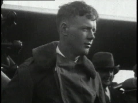 lindbergh posing then lindbergh posing with his mother while visiting her before his trip / united states - 1927 stock videos and b-roll footage