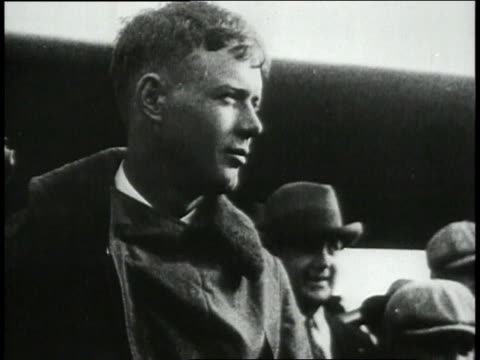 lindbergh shaking hands / lindbergh climbing into airplane's cockpit / lindbergh smiling from airplane window - 1927 stock videos and b-roll footage