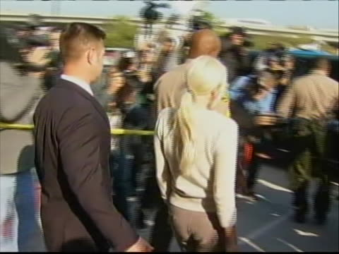 lindsay lohan arrives at the los angeles superior court wednesday, dec. 14, 2011. a judge says lindsay lohan is doing well under her strict new... - crime or recreational drug or prison or legal trial stock videos & royalty-free footage