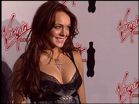 lindsay lohan at the 2004 mtv movie awards virgin cola after party at fame@xes in hollywood, california on june 5, 2004. - mtvムービー&tvアワード点の映像素材/bロール