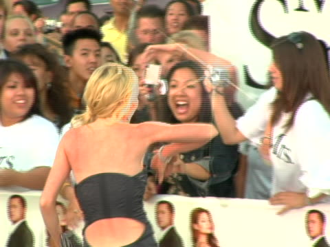 Lindsay Lohan greets fans at the World Premiere of Mr Mrs Smith at Mann Village Theatre in Westwood CA