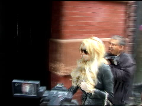 Lindsay Lohan rushes pass the paparazzi as she arrives at the Mercer Hotel in New York 04/12/11