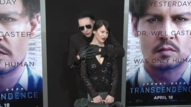 lindsay usich and marilyn manson at the transcendence los angeles premiere at regency village theatre on april 10 2014 in westwood california - マリリン マンソン点の映像素材/bロール
