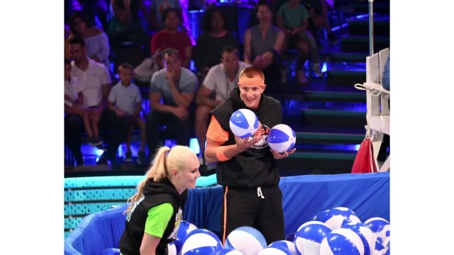 Lindsey Vonn and Rob Gronkowski participate in a challenge onstage during Nickelodeon Kids' Choice Sports 2019 at Barker Hangar on July 11 2019 in...