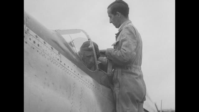 a line of airmen salute their leader and walk to airplanes one climbs into his cockpit and the propeller's motor starts up a line of the aircraft... - unvollständig stock-videos und b-roll-filmmaterial