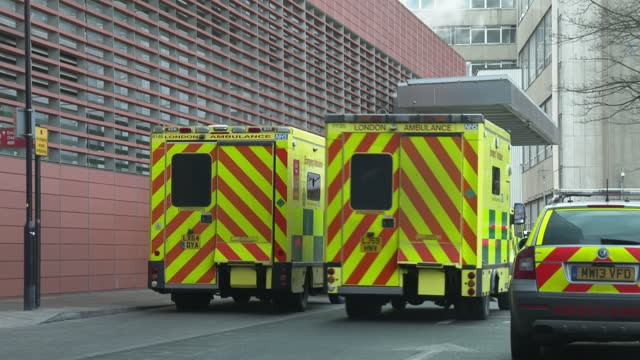 line of ambulances outside the royal london hospital in east london on january 3, 2021. - the british prime minister said on january 3 he was... - swirl stock videos & royalty-free footage