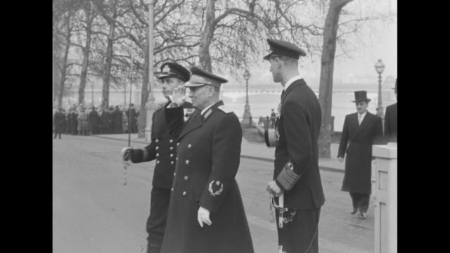 line of british sailors begins to present arms pan yugoslav president josip tito salutes as he stands on embankment of london's thames river he has... - winston churchill politik stock-videos und b-roll-filmmaterial