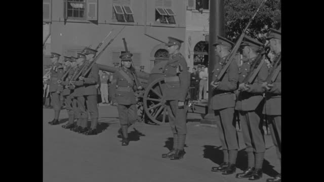 stockvideo's en b-roll-footage met line of british soldiers marches up to other line of soldiers in front of artillery piece and performs drill / line of soldiers presents arms while... - british military