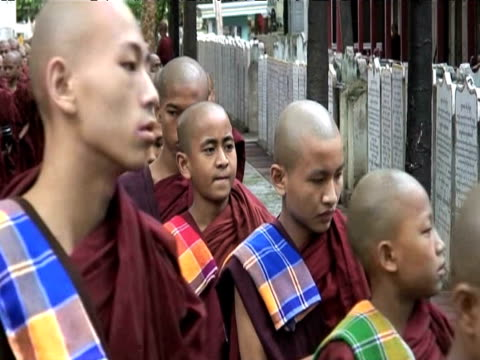 Line of Buddhist monks walking into monastery 19 June 2009