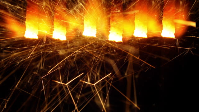 A line of burning sparklers.