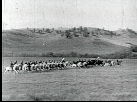 1860 b/w montage ws pan pov line of cavalrymen galloping across plain / usa - cavalry stock videos & royalty-free footage