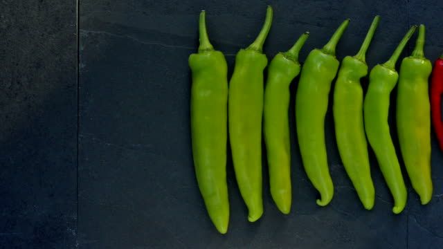 line of chillies - standing out from the crowd stock videos & royalty-free footage