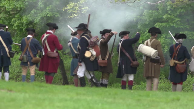 a line of colonial soldiers in the revolutionary war fire muskets. - colonial stock videos & royalty-free footage