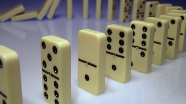 cu, line of dominos collapsing - dominoes stock videos & royalty-free footage