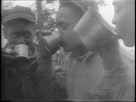 line of drivers outside tent ready to get hot coffee and food / tent and sign that says coffee for drivers / close up of african american troops... - la manche stock videos and b-roll footage