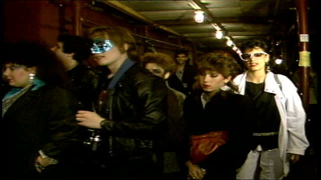 line of fans walking into theater to see the rocky horror picture show - 1985年点の映像素材/bロール