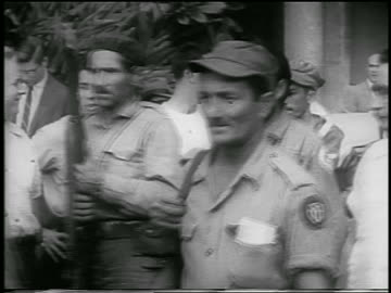 line of guerrilla soldiers carrying guns walking past camera outdoors / cuba / newsreel - 1959 stock videos & royalty-free footage