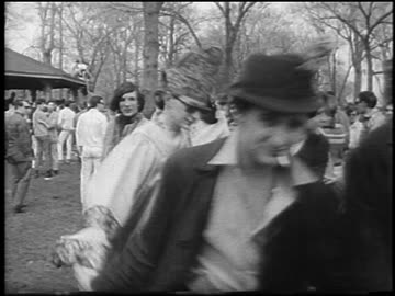 line of hippies holding hands walking past camera at be-in / belle isle, detroit / newsreel - 1967 stock videos & royalty-free footage