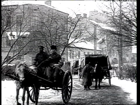 1915 b/w ws line of horse-drawn hospital carts carrying war victims and wounded soldiers/ russia - world war i stock videos and b-roll footage