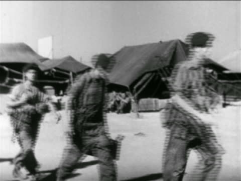 line of israeli soldiers walking past camera in camp / suez crisis / newsreel - 1956 stock videos & royalty-free footage