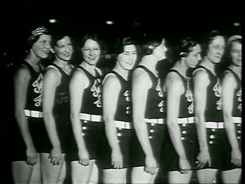 b/w 1930 line of jewish female basketball players from the house of david smiling in uniforms / chicago / newsreel - people in a row stock videos & royalty-free footage