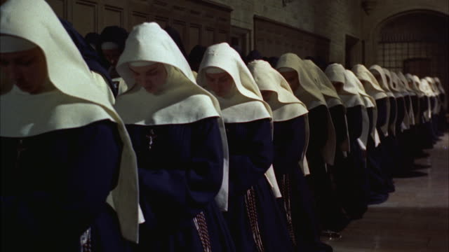 MS PAN Line of kneeling nuns