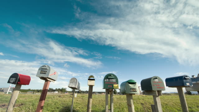 vídeos de stock e filmes b-roll de t/l, ms, line of letterboxes on rural road, south island, new zealand - letterbox