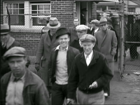 b/w 1944 line of male blue collar workers exiting factory thru gate - 1944 stock videos and b-roll footage