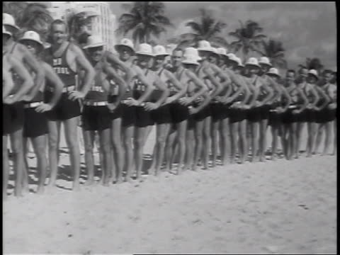 b/w 1937 line of male lifeguards posing in beauty contest / florida / newsreel - beauty contest stock videos & royalty-free footage