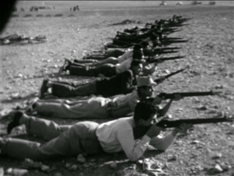 line of men lying on ground aiming rifles / syria / newsreel - 1957 stock videos & royalty-free footage