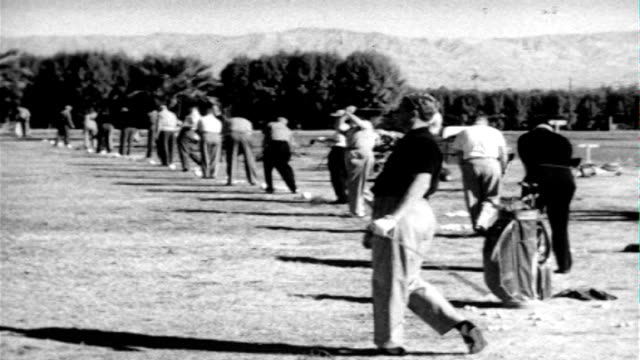 ws line of men practicing at driving range w/ mountains bg td ms male golfer in two tone shoes using wedge club hitting golf ball off of sand tu... - getönt stock-videos und b-roll-filmmaterial