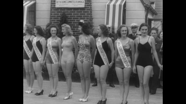 vídeos de stock, filmes e b-roll de line of miss america contestants outside at steel pier in atlantic city nj / cu winner marilyn meseke of ohio wearing crown and sash - beauty queen
