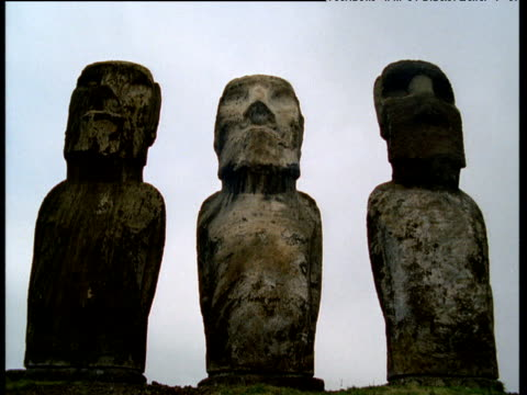 line of moai monolithic statue - polynesian culture stock videos & royalty-free footage