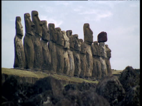 line of moai monolithic statues - polynesian culture stock videos & royalty-free footage