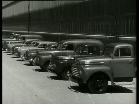 b/w line of new cars and trucks parked by ford factory / sound - ford motor company stock videos and b-roll footage