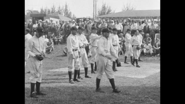 line of new york yankees baseball players warming up during spring training in florida / vs lou gehrig bats runs / cu yankee coach jimmy burke... - lou gehrig stock videos & royalty-free footage