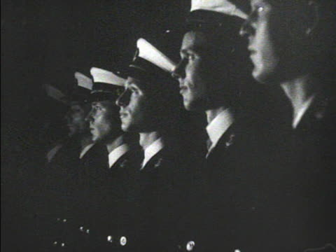 line of officer candidates midshipmen w/ hats off looking up putting hats on spelling out navy chanting 'holy father' - chanting stock videos and b-roll footage