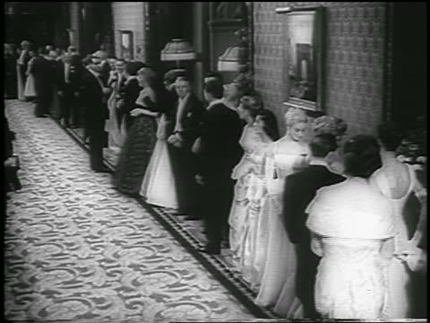 line of people in formalwear wait in hallway to meet queen / london / newsreel - england stock videos & royalty-free footage
