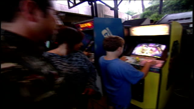 Line of People Playing Classic Arcade Games in Los Angeles California