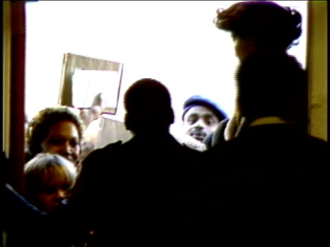 line of people waiting to get into a record store to met eddie murphy - eddie murphy stock videos & royalty-free footage