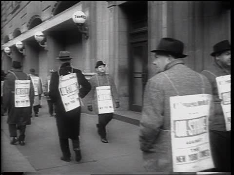 line of people with sandwich boards walking in picket line on sidewalk / newspaper strike - newspaper strike stock videos & royalty-free footage