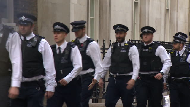 A line of police officers arriving at 10 Downing Street