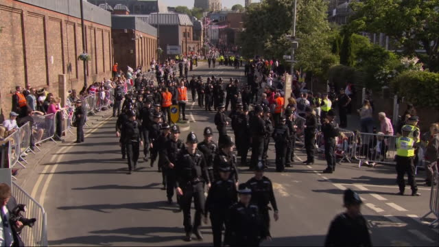 a line of police officers makes its way along a street in windsor ahead of the wedding of prince harry and meghan markle - security stock videos & royalty-free footage