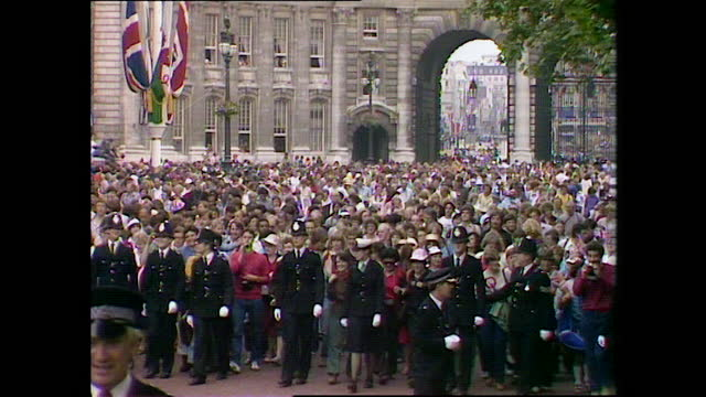 line of police walk in front of crowds of spectators as they make their way to buckingham palace on the day of the wedding of prince charles and lady... - square stock videos & royalty-free footage
